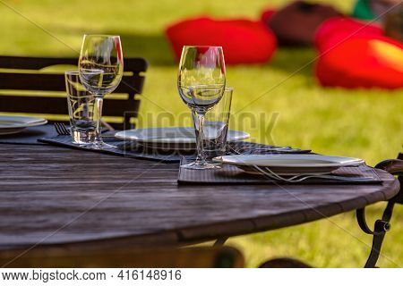 Beautifully Laid Tables With Glasses And Appliances In The Cafe. Banquet Service, Catering. Empty Wi