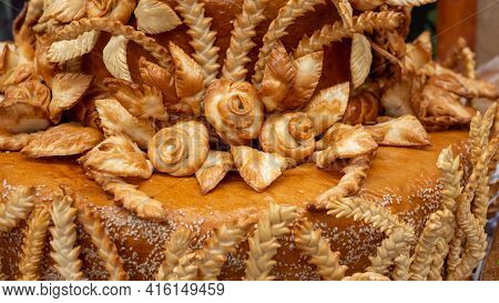 Food Background. Toasted Golden-yellow Pie Crust. A Piece Of White Bread With A Golden Crust And Flo