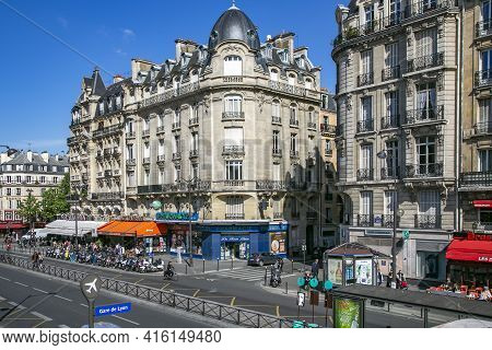 France, Paris, May, 20, 2015 - Old Historical Stone Parisian Buildings In The Center Of Paris With S