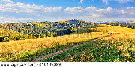 The Beautiful Panoramic Landscape Of The Carpathians In The Daytime And The Road Winding Along The R