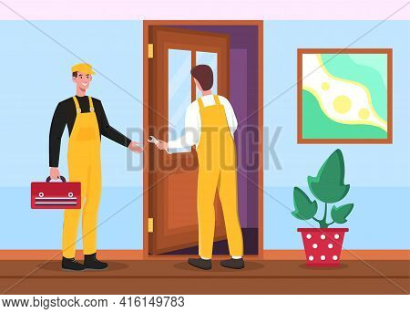 Two Male Workers In Uniform With Wrench Are Installing Door. Two Cheerful Men In Yellow Overalls Are