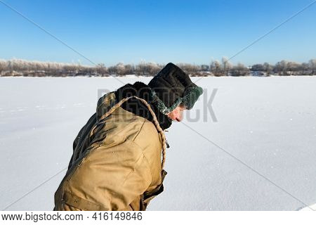 Moscow, Russia - February 15, 2021: Lonely Old Hermit Man, In Winter Crosses The River On Ice