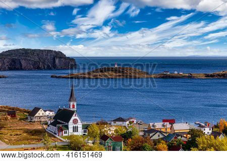Aerial View Of A Small Town On The Atlantic Ocean Coast. Dramatic Colorful Blue Sky Art Render. Take