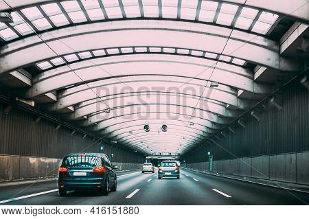 Speeding Cars Traffic Inside A Highway Urban Tunnel. Trip Travel Concept On Vehicle. Urban City Road