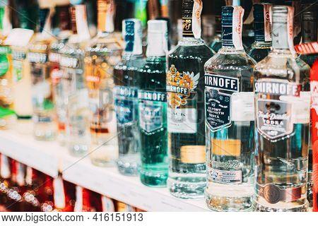 Nerja, Spain - June 20, 2015: Vodka Bottles On Shop Shelves. Vodka Smirnoff Bottles In Alcoholic Tra