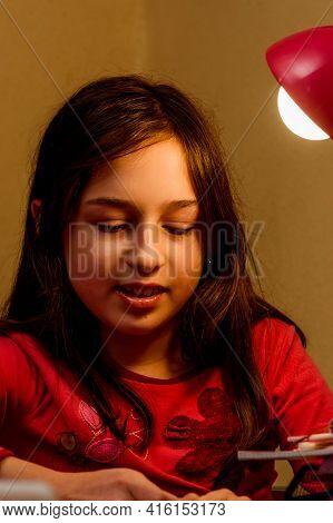 Teenage Girl Doing Homework For School. Teen Doing Homework
