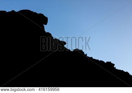 The Silhouette Of The Cliffs Of Kukenan Tepui Or Mount Roraima  With Clouds And Blue Sky. Gran Saban
