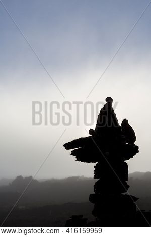 Silhouette Of The Stacked Stones On Kukenan Tepui Or Mt Roraima  With Clouds In The Morning. Gran Sa