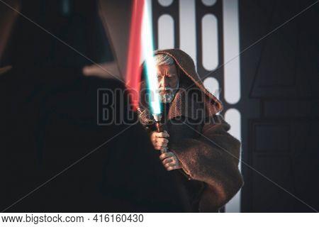 APRIL 8 2021: Scene from Star Wars A New Hope when Sith Lord Darth Vader strikes down Jedi Obi-Wan Kenobi - customized Hasbro action figure