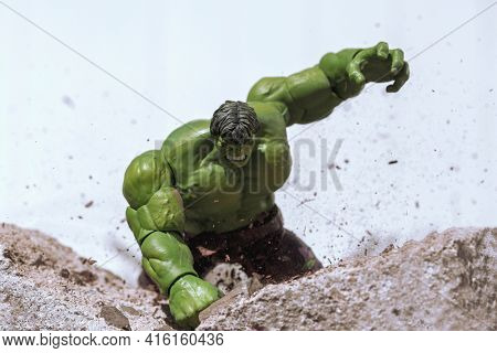 APRIL 8 2021: Scene from Marvel's The Avengers - Hulk Smash - smashing the pavement  - Hasbro action figure
