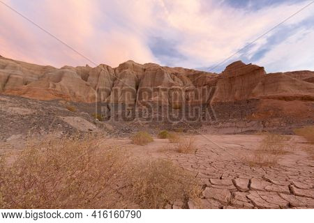 Pink And Red Colored Sunset With Geological Rock Formations At Rodeo Near The Lake Of Wind (dique De