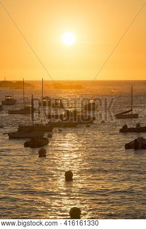 Sunset On The Harbour Of Tregastel With (between Perros-guirec And Pleumeur-bodou, Brittany, France)