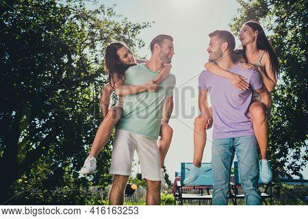Photo Of Company Four Fellows Having Fun Piggyback Smiling Outside Outdoors Garden Park Forest