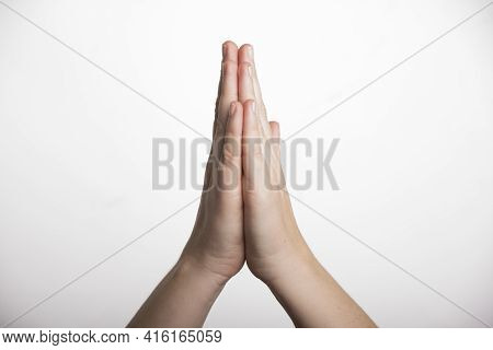 Person Holding Hands In Prayer, Religious Symbol Of Faith And Devotion