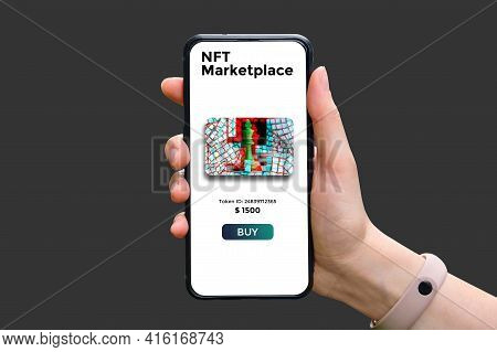 Hand Holds Smartphone With Type Of Cryptographic Nft Marketplace With Art Sale