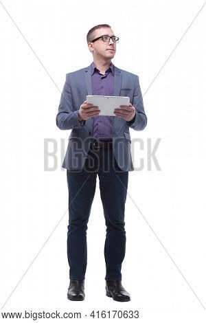 Full lenth portrait of cool businessman using electronic tablet