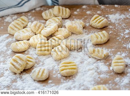 Home Made Gnocchi With Flour On Wooden Pastry Board. Hand Made Gnocchi Di Potato, Traditional Italia