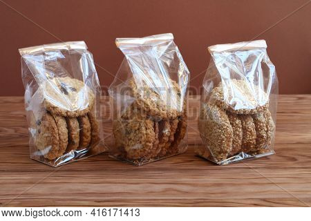 Three Types Of Oatmeal Cookies - With Chocolate, Walnuts And Raisins, And Sesame Seeds - In Transpar