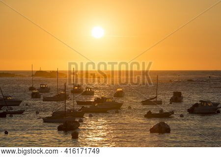 Tregastel, France - 28/07/2014: Sunset On The Harbour Of Tregastel With (between Perros-guirec And P