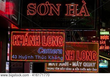 Different Neon Lights Signs At Night In The Busy City Of Ho Chi Minh City (saigon). Vietnam