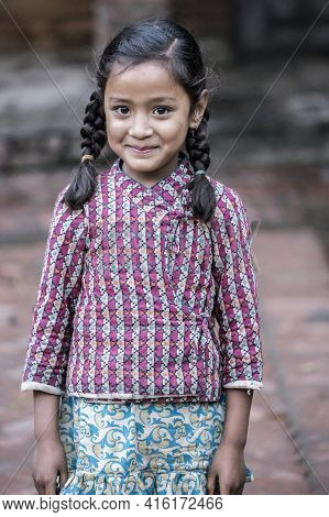 Bhaktapur, Nepal, April 23: Portrait Of A Young Nepalese Kid Looking At The Camera With Makeup Aroun