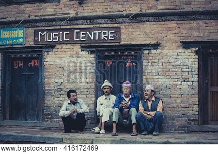 Nepal, Bhaktapur, April 24: A Unidentified Group Of Men In Bhaktapur Talking In The Street.in Front