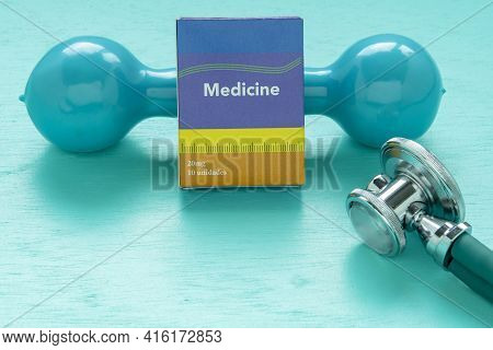 Medicine Box And Weight For Physical Exercise Symbolizing Mental Balance