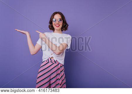 Happy White Girl In Elegant Sunglasses Posing With Pleasure In Studio. Indoor Photo Of Laughing Good