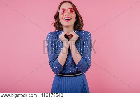 Charming European Young Woman In Blue Blouse Laughing On Pastel Background. Enthusiastic White Girl