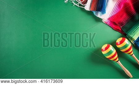 Cinco De Mayo Holiday Background Made From Maracas, Mexican Blanket Stripes Or Poncho Serape On Gree