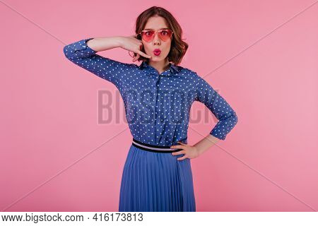 Good-looking Young Lady With Wavy Hairstyle Posing In Studio In Blue Attire. Elegant European Woman