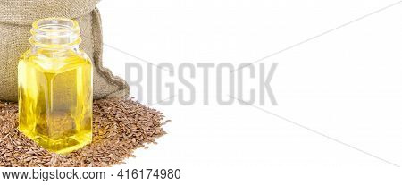 Flax Essential Oil. Glass Bottle Of Flax Oil.flax In A Sack Of Isolated On A White Background.. Heal