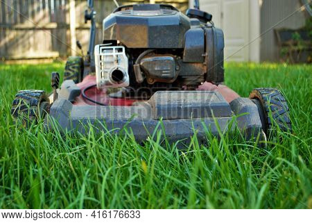 Ground Level View Of A Lawnmower In Tall Grass
