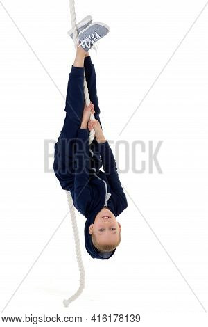 Active Boy Swing Upside Down On The Rope