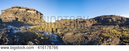 Panorama At The Top Of Mount Roraima In The Morning With Blue Sky. Black Volcanic Stones, Water And