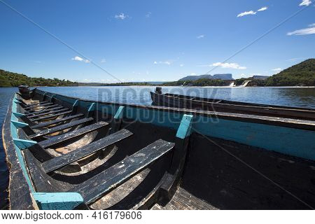 Blue Wooden Boats In Front Of Hacha Falls In The Lagoon Of Canaima National Park Venezuela 2015.