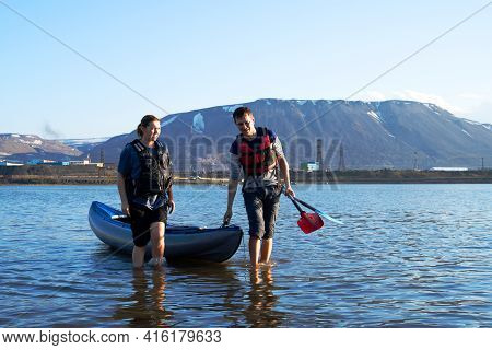Norilsk, Russia - June 20, 2017: A Man And A Woman Are Canoeing On A Mountain Lake.