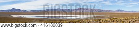 Panorama Of Mountains And White Salt Pan In Eduardo Avaroa Andean Fauna National Reserve Against A C