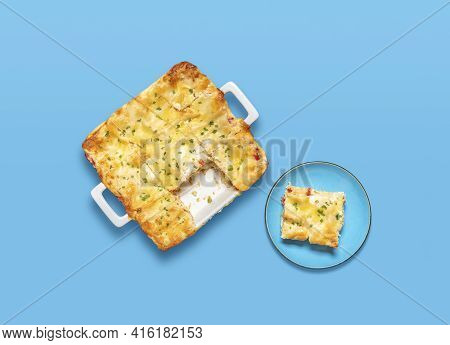 Above View With A Homemade Vegetarian Lasagna On A Blue Table. Tray Of Freshly Baked Lasagna And A P