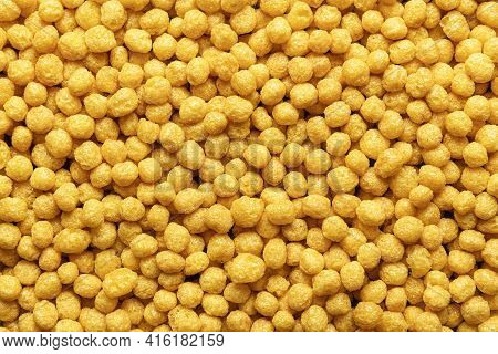 Honey Pops Breakfast Cereals Background, Flat Lay. Full Frame With Cornflakes. Delicious Corn Cereal