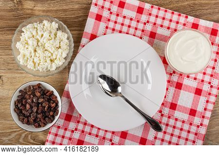 Transparent Glass Bowl With Cottage Cheese, Bowl With Raisin, Spoon In White Plate, Bowl With Sour C