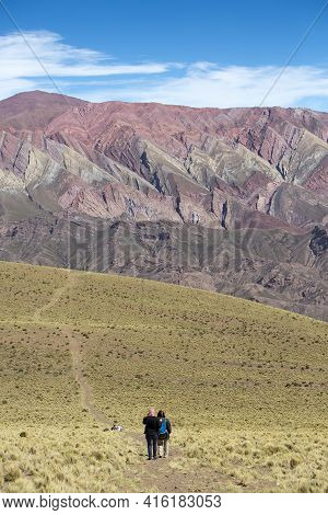 Humahuaca, Argentina, Dec 21: Undefined Group Of Tourists Walking Towards The Mountain Of Fourteen C