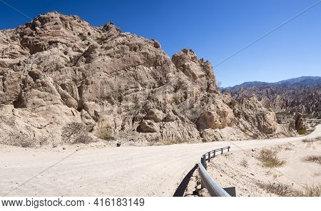 Geological Rock Formation With Famous Gravel Dirt Ruta 40 - Route 40 - Along The Andean Mountains Wi