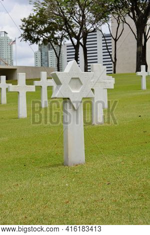 MANILA, PHILIPPINES - APRIL 1, 2016: Cross at Manila American Cemetery. With 17,206 graves it is the largest WWII cemetery for US personnel.