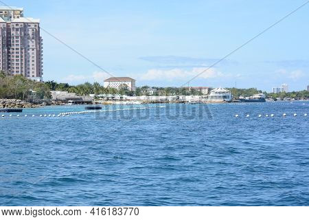 CEBU, PHILIPPINES - APRIL 5, 2016: Shangri-La Mactan Resort and Spa seen from the water. The luxury resort features a Marine Sanctuary.