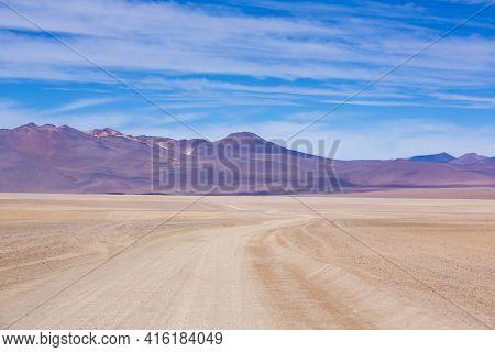 Sandy Road And Colored Mountains In The Atacama Desert With Blue Sky In Eduardo Avaroa Andean Fauna