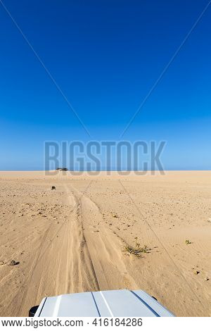 Front Of 4x4 Vehicule Driving In Sandy Track In Punta Gallinas With Clear Blue Sky, La Guajira, Colo