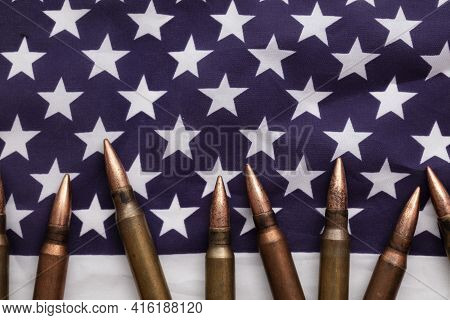 Bullet Ammunition On A United States Stars And Stripes Flag