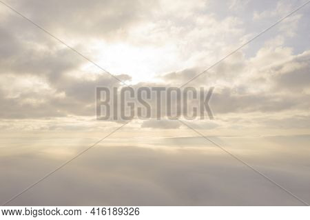 Aerial View White Clouds In Blue Sky. View From Drone. Aerial Top View Cloudscape Texture. Texture O