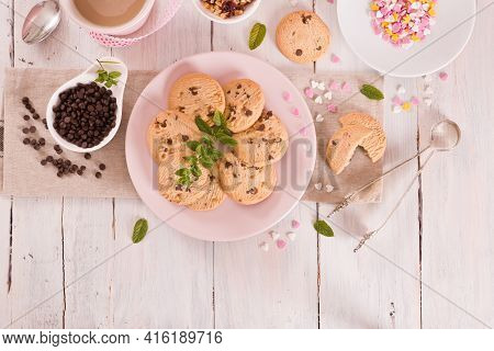 Chocolate Chip Cookies With Mint On White Dish.